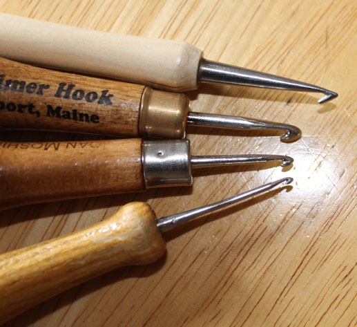 From top to bottom: Primitive hook, coarse hook, medium hook, fine hook.